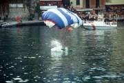 The splashdown of a parachutist in the middle of Portofino harbour