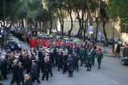 Blue color of the uniforms of the Navy, Green of the commandos, Red of the numerous Fire Brigade Divers