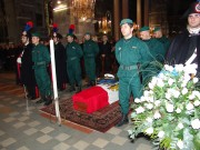 The casket enveloped in the Navy Italian flag, on the cushion his medals and military ranks